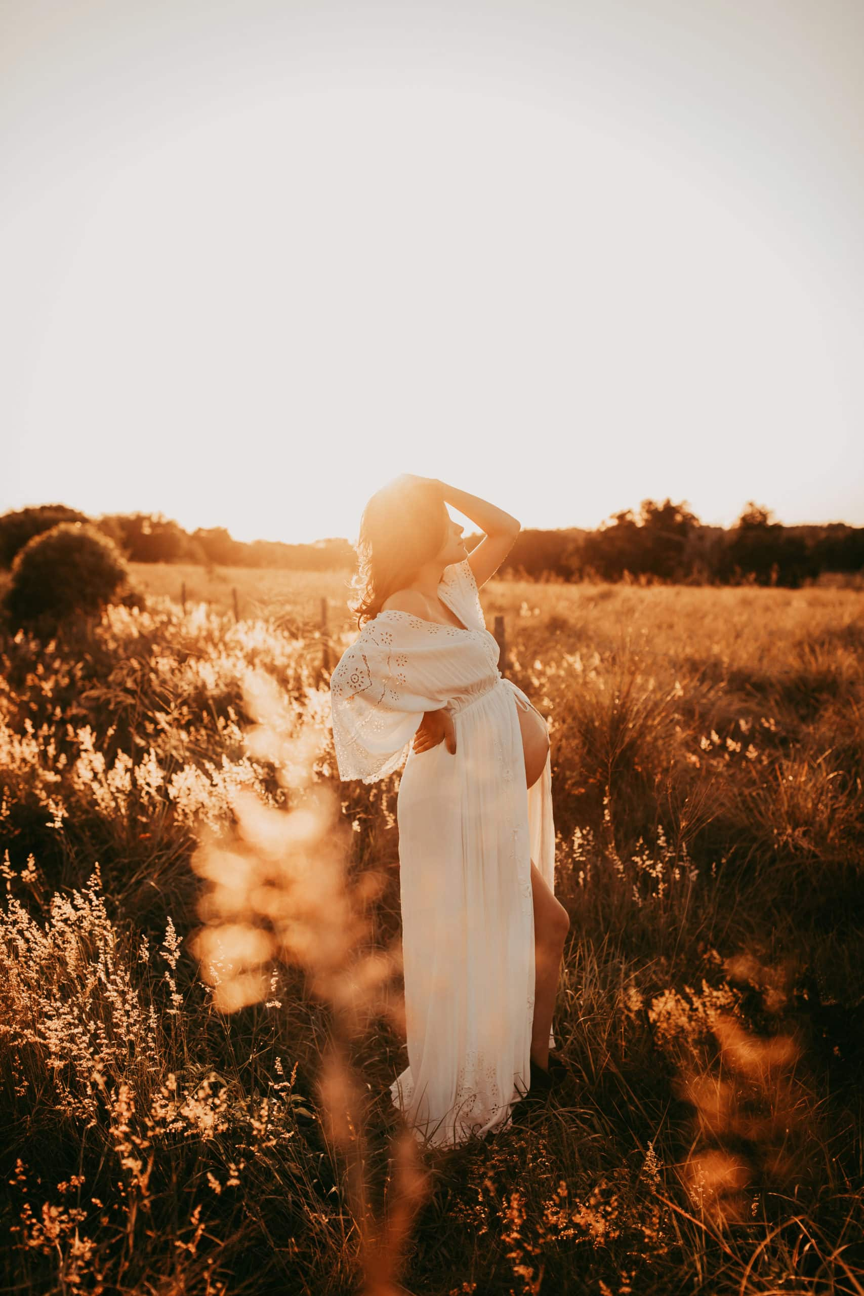 Orlando Maternity Photographer, woman standing in field with a white dress