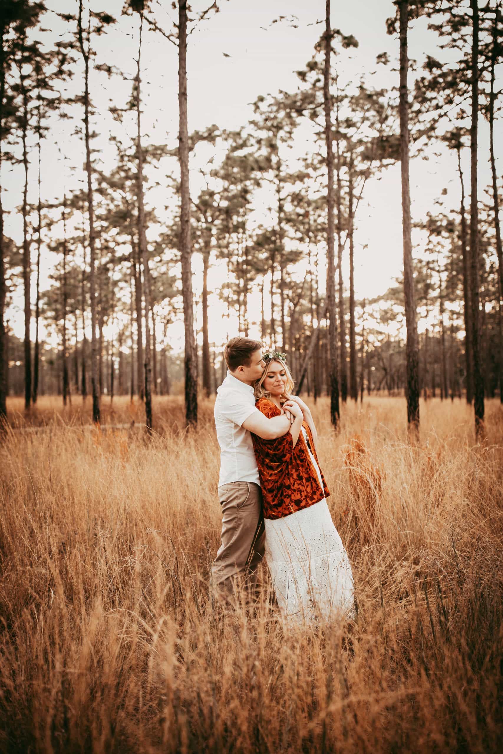 Orlando Couples Photography, couple cuddled up together in a field
