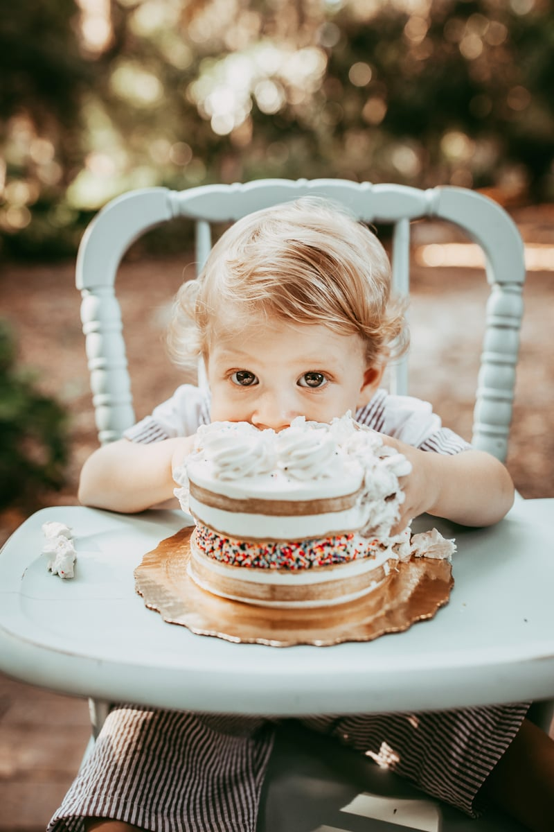 Orlando Cake Smash Photographer, little boy eating sprinkle cake in highchair