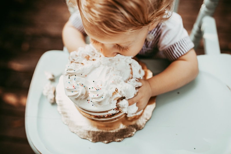 Orlando Cake Smash Photographer, close up of little boy eating cake in highchair