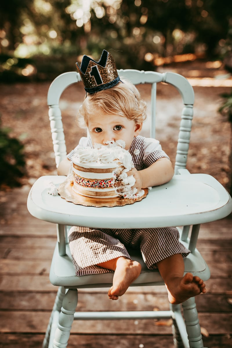 Orlando Cake Smash Photographer, little boy eating cake in highchair