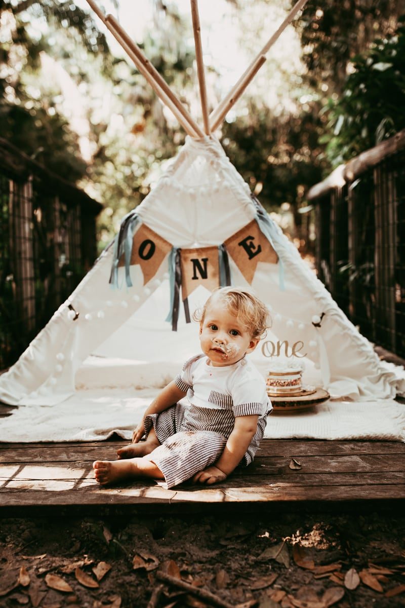 Orlando Cake Smash Photographer, little boy sitting in front of a teepee