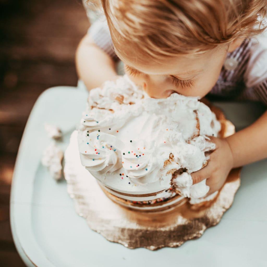 Orlando Cake Smash Photography. little boy smashing face into a white birthday cake