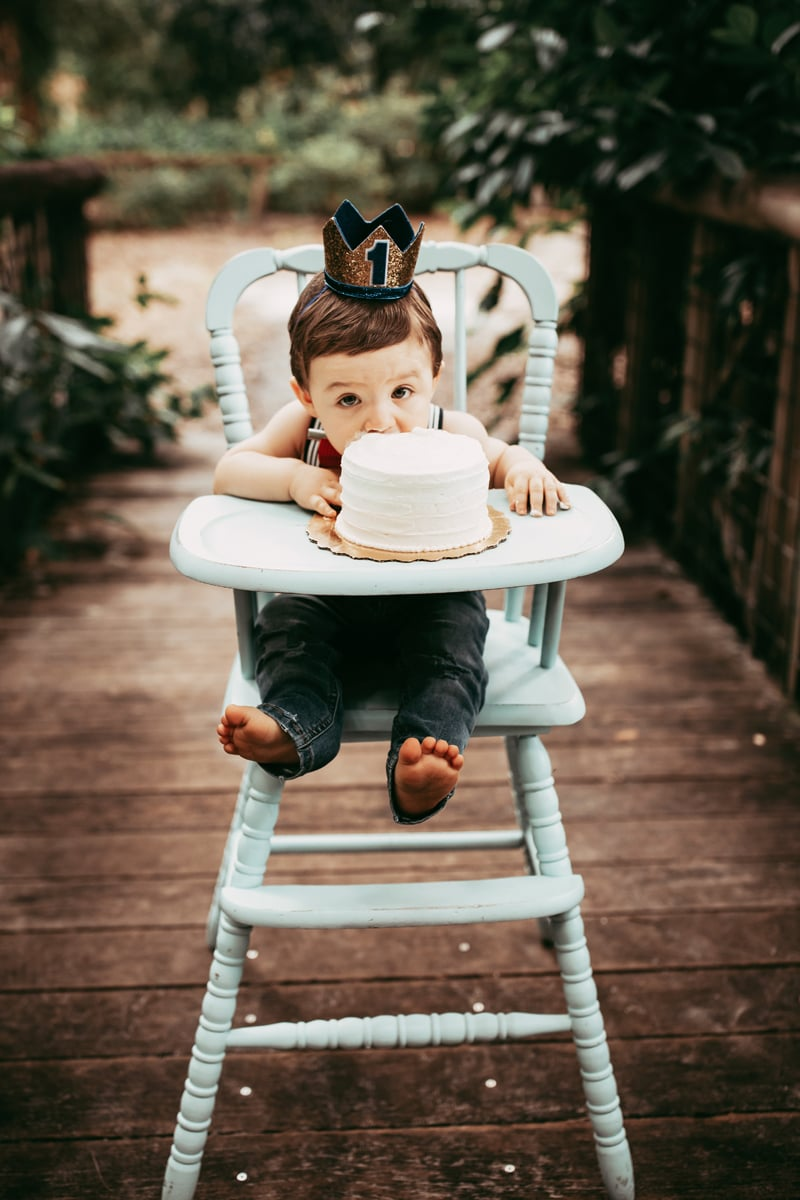 Orlando Cake Smash Photographer, little boy looking at camera over his cake