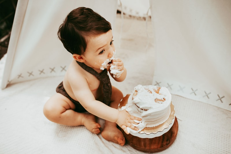 Orlando Cake Smash Photographer, little boy eating white cake