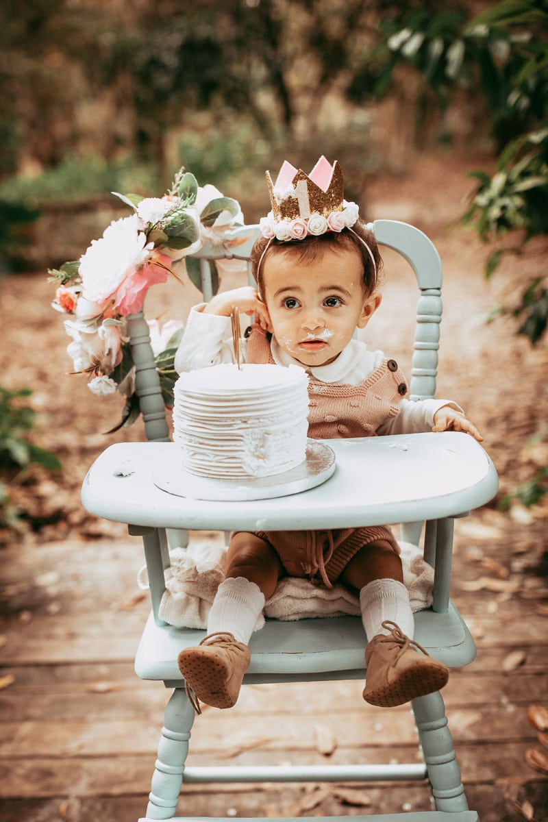 Orlando Cake Smash Photographer, little girl eating a cake in highchair