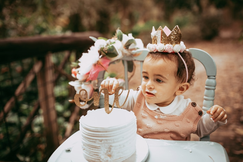 Orlando Cake Smash Photographer, little girl eating cake in highchair