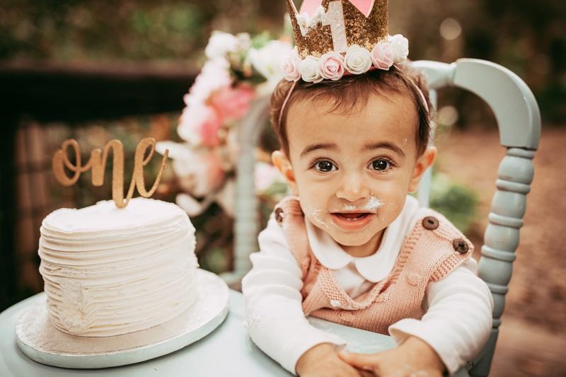 Orlando Cake Smash Photographer, little girl with cake on her face