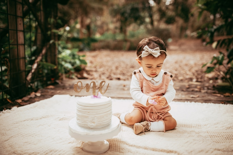 Orlando Cake Smash Photographer, little girl sitting next to cake