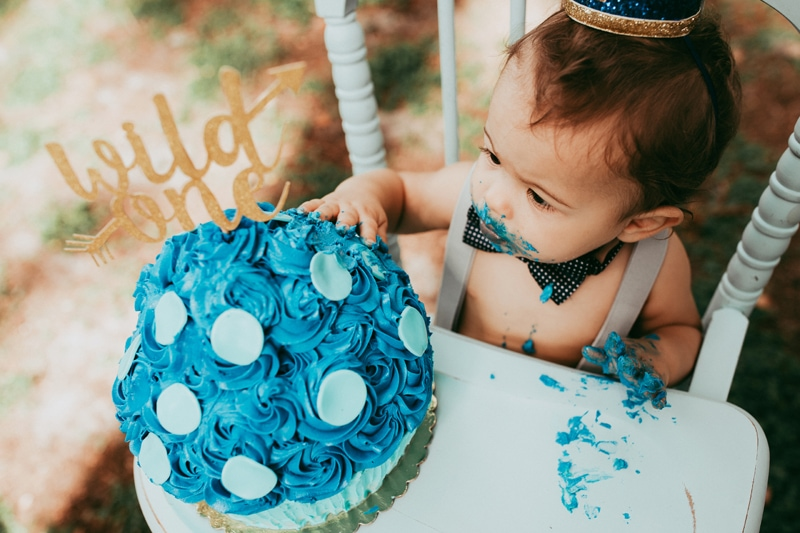 Orlando Cake Smash Photographer, little boy eating blue cake in highchair