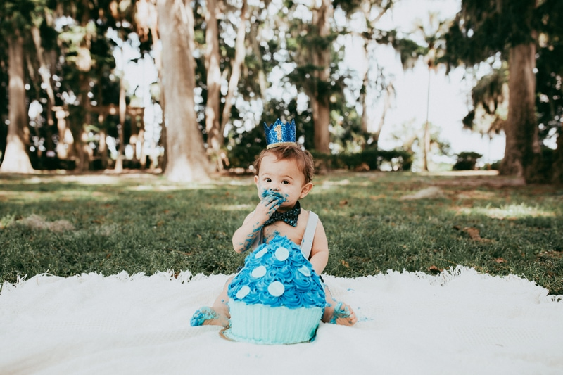 Orlando Cake Smash Photographer, little boy eating blue cake