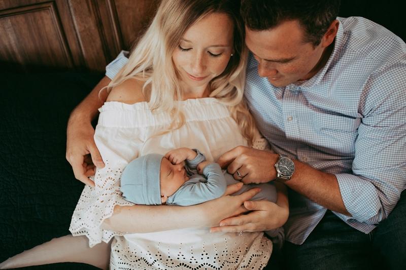 Orlando Newborn Photography, couple looking at newborn baby boy