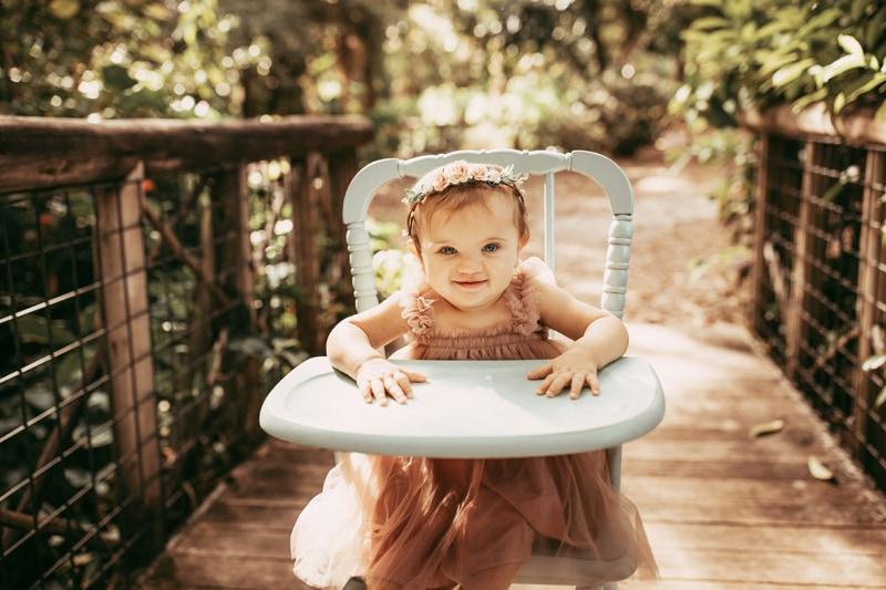 Orlando Cake Smash Photographer, little girl in highchair