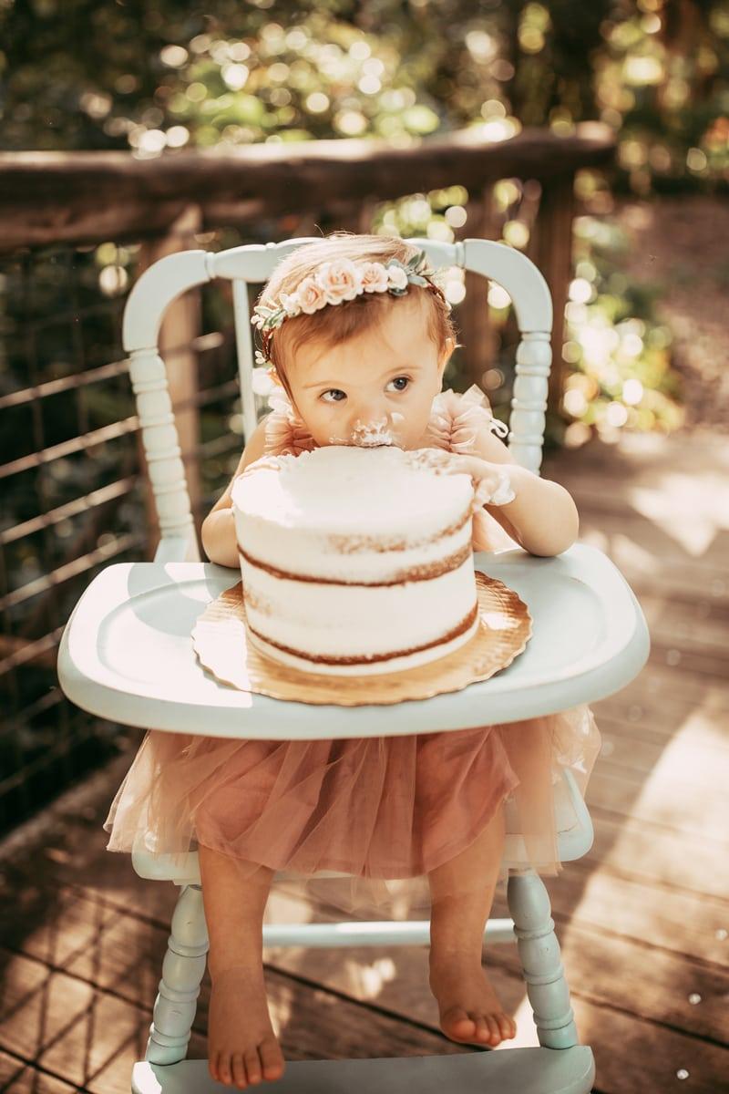 Orlando Cake Smash Photographer, little boy eating white cake in highchair