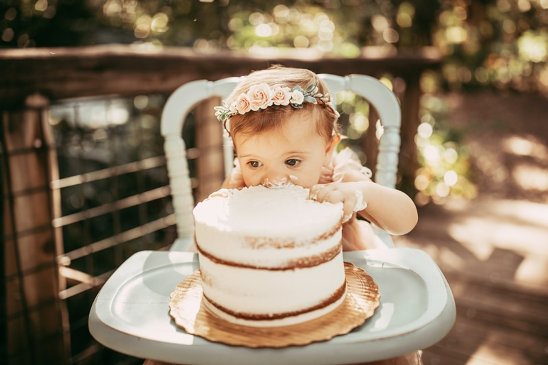 Orlando Cake Smash Photographer, little girl eating white cake in highchair