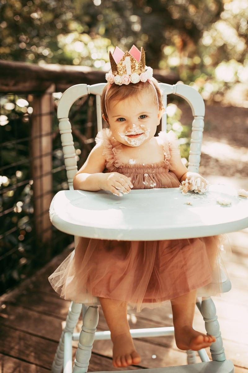 Orlando Cake Smash Photographer, little girl smiling with cake on her face