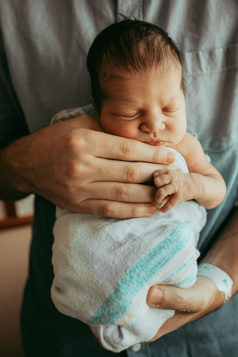 Orlando Fresh 48 Photographer, baby sleeping in swaddle in father's arms