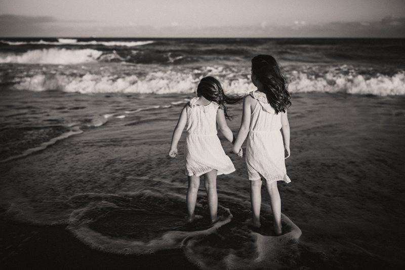 Orlando Family Photographer, black and white image of two young sisters at the beach