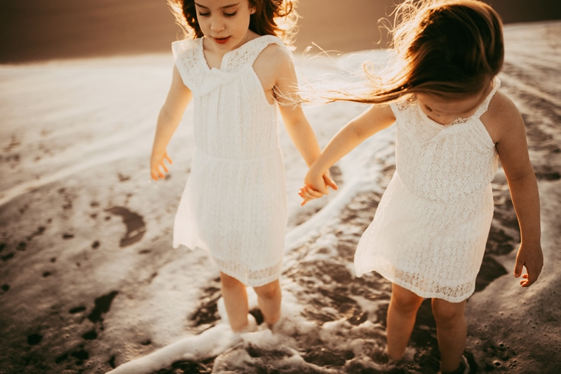Orlando Family Photographer, two young sisters walking hand in hand