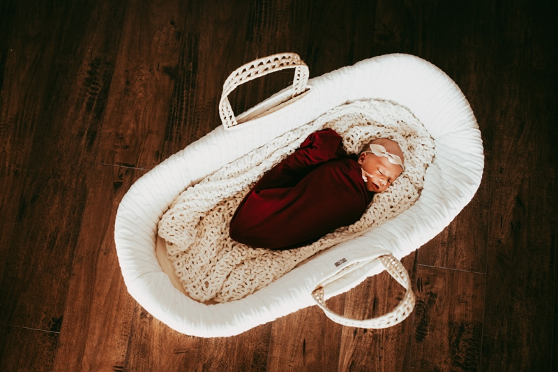 Orlando Newborn Photographer, newborn baby swaddle and asleep in moses basket