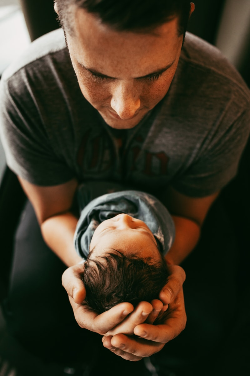 Orlando Fresh 48 Photographer, father holding newborn baby